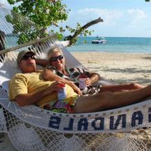 honeymoon koozies on a hammock in sandals