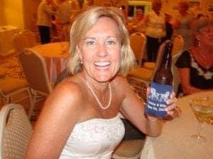 pretty lady holding blue wedding koozie