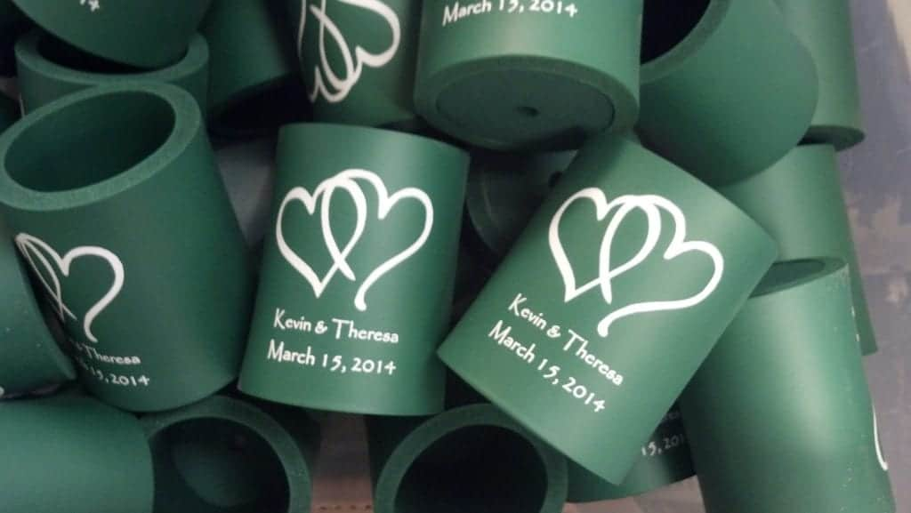 Green foam hearts over names wedding cozy