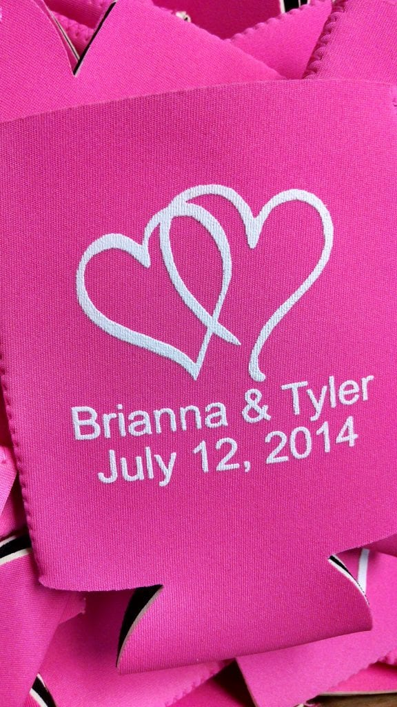 Pink hearts over names wedding koozies